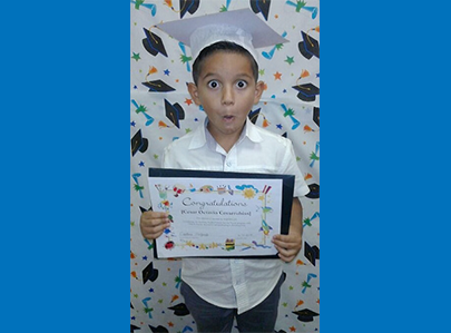 Boy with graduation cap and certificate
