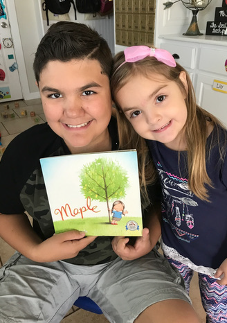 kids-holding-book