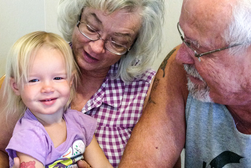 grandparents-with-granddaughter