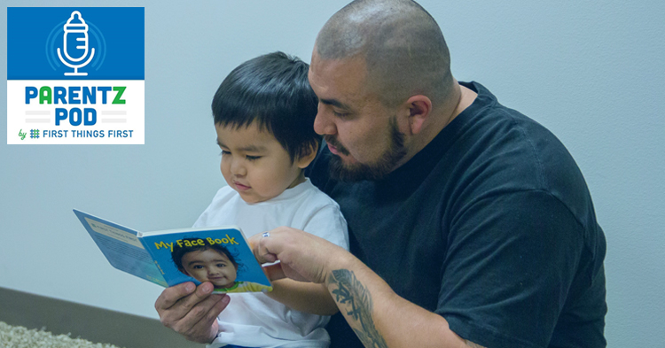 Father and toddler son reading together