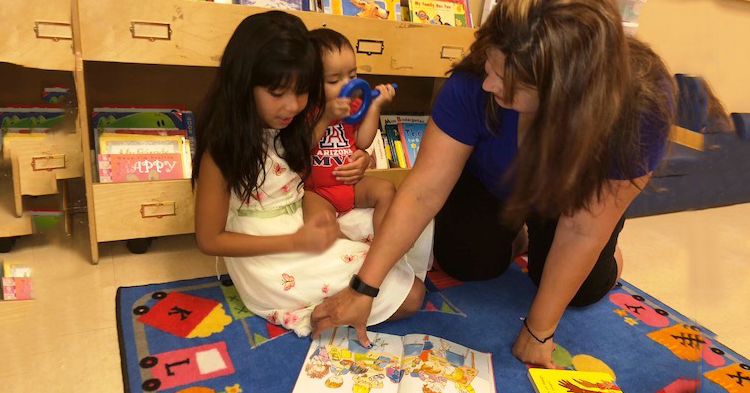 Girl in preschool with teacher