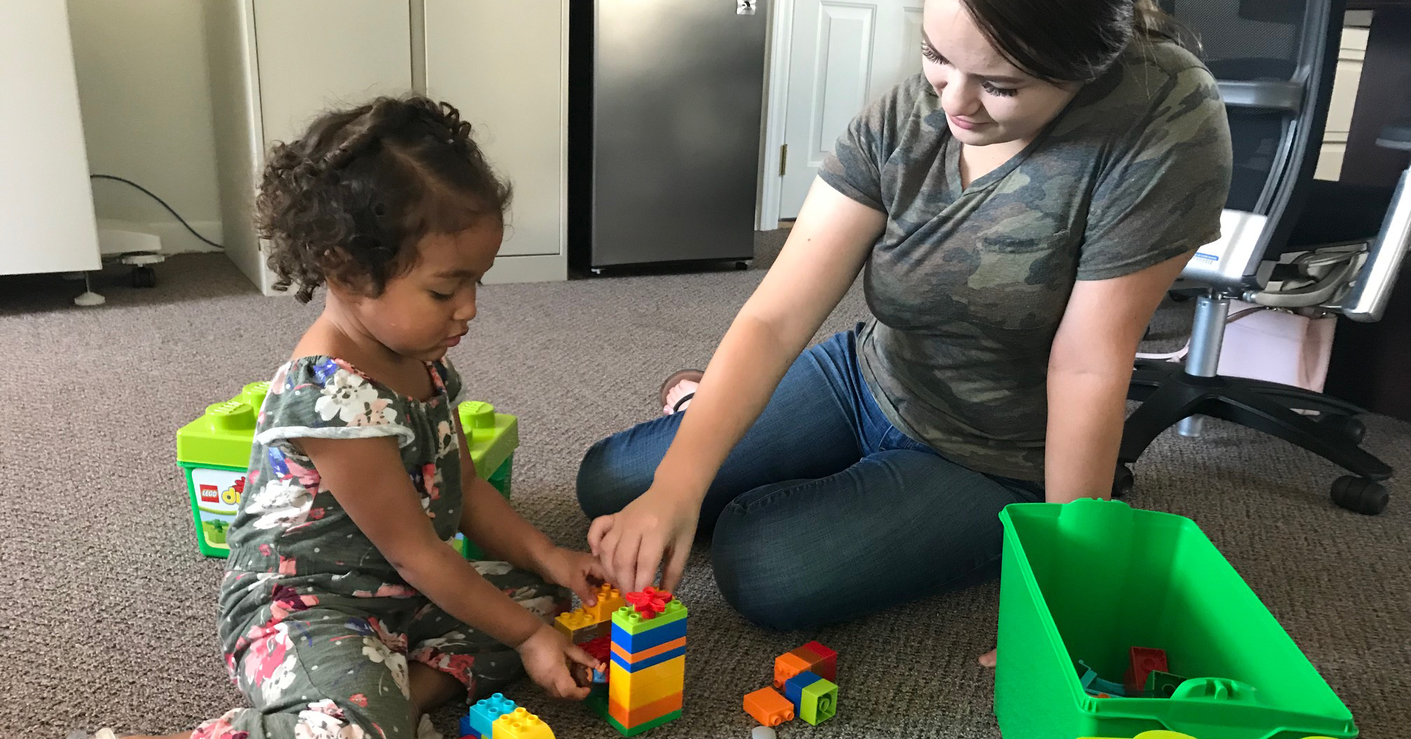 Daughter and mother playing with blocks