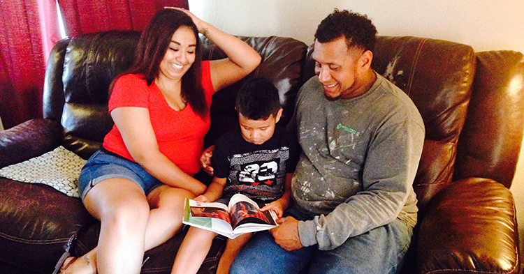 Mom and dad reading with son