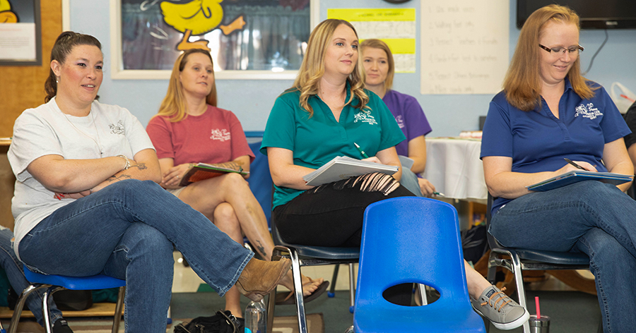early educators sitting in professional development class