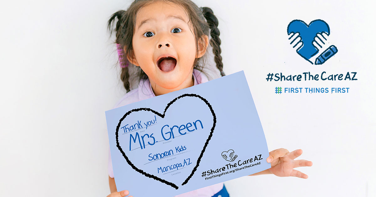 little girl holding share the care sign