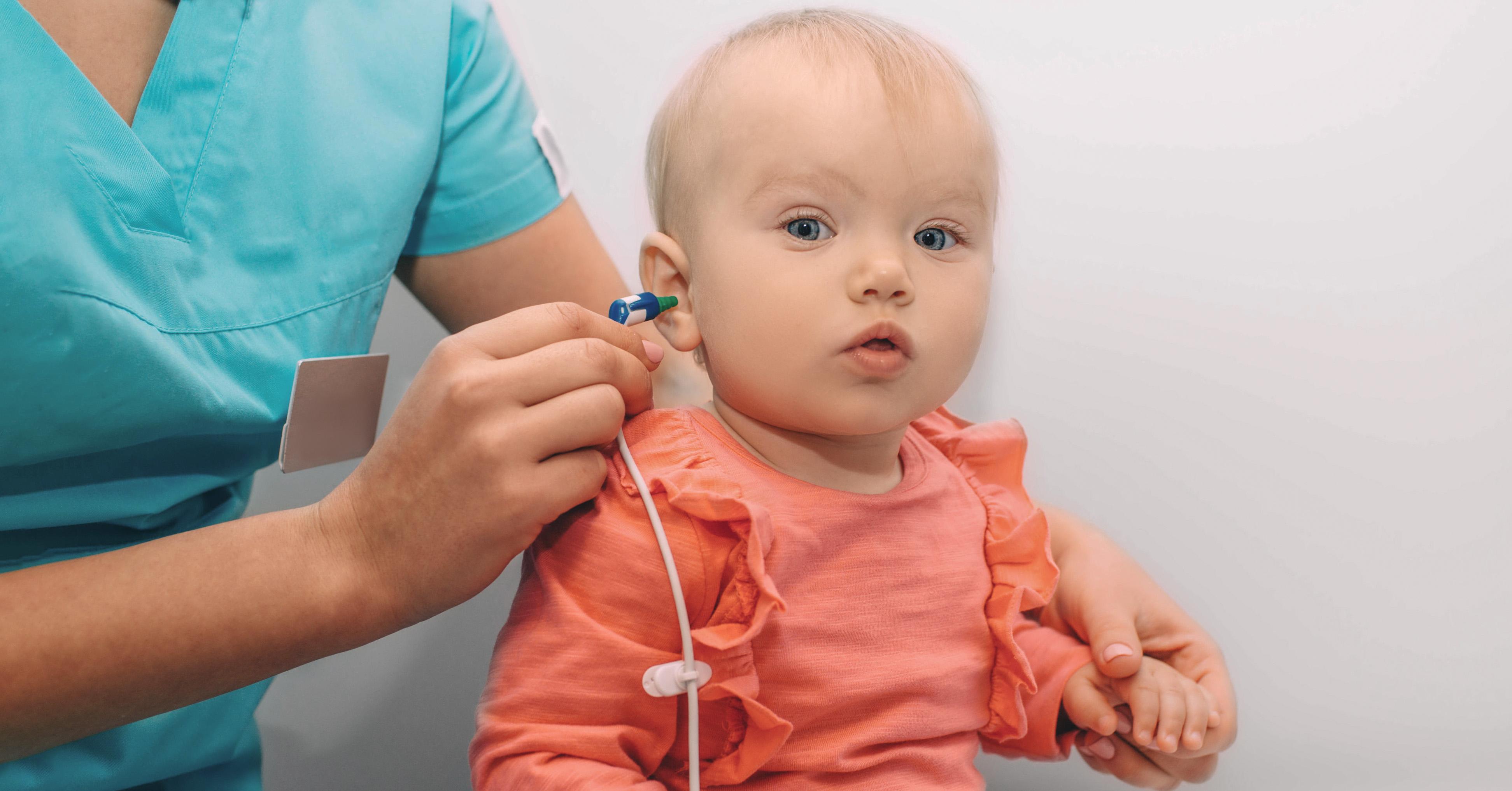 baby girl getting hearing screened