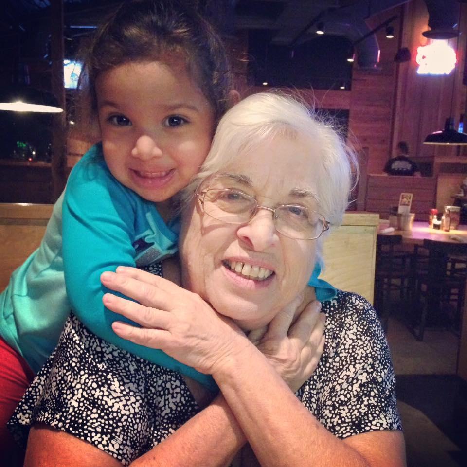 granddaughter hugging grandmother at a restaurant