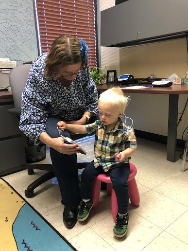 Young boy getting a hearing exam.
