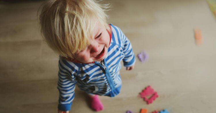 crying toddler standing